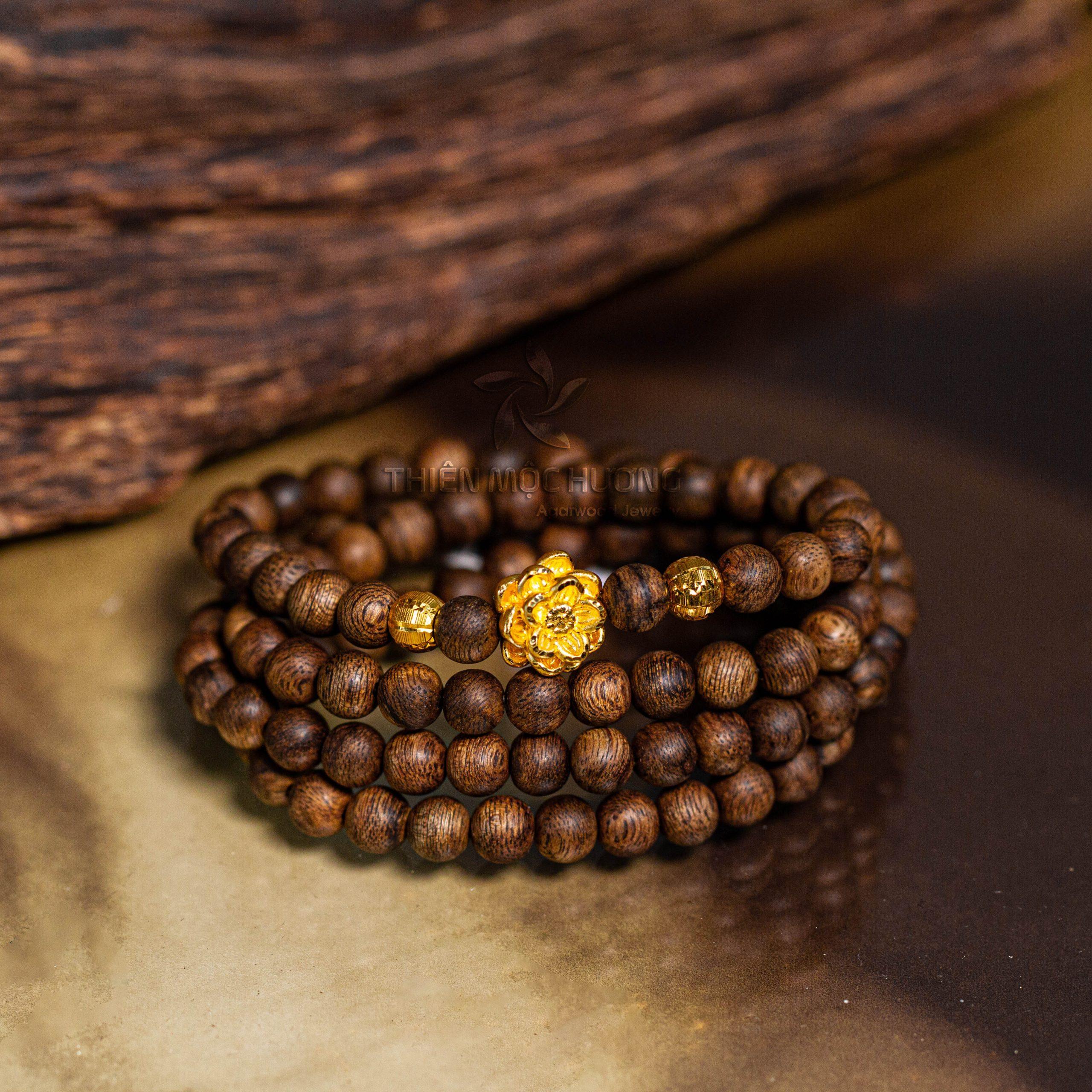 Blossom Philippines agarwood beaded bracelet with 24k gold charm