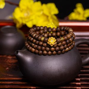 Blossom Philippines agarwood beaded bracelet with 24k gold charm